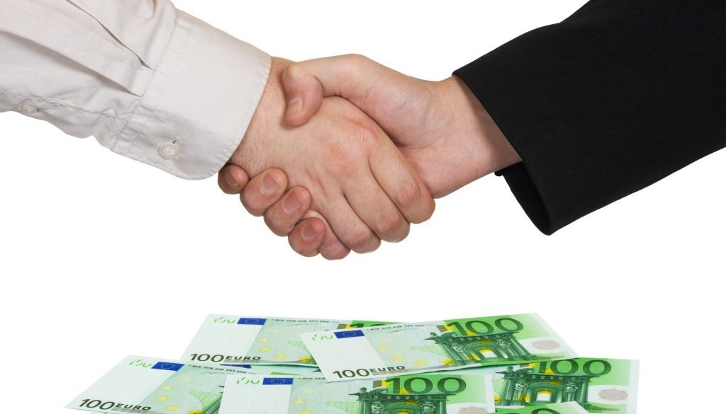 Handshake and money Euro